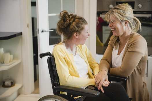 Disability Support Worker and Client smiling