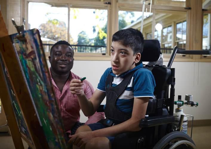 community access. Boy paints on canvas
