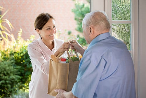Disability Support Worker Delivering Groceries