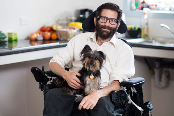 Man in electric wheelchair with dog