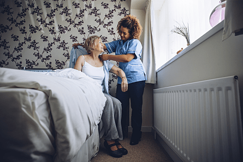 Disability Support Worker Helping Client